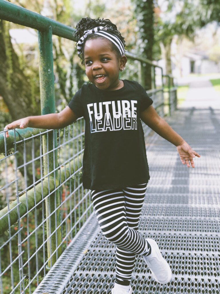 """smiling small black girl with """"future leader"""" on blouse"""